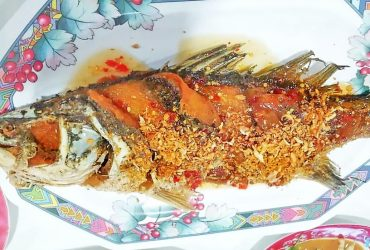 Deep fried sea bass topped with sweet sour and hot sauce