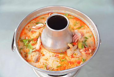 Hot and sour Tom Yum milky soup with seafood